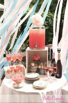 Pink lemonade and champagne glasses. Rim the glasses in pop rocks. For kids party.