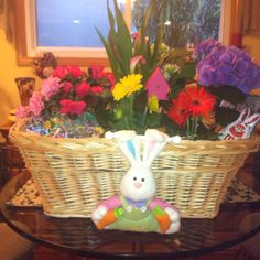 Great Easter basket idea. Line a basket with heavy duty plastic, fill with dirt, and plant spring flowers. Add candies or other Easter goodies.