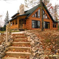 Log Home By Golden Eagle Log Homes - golden eagle log logs cabin home homes house houses rustic knotty pine custom design designs designer floor plan plans kit kits building luxury built builder complete package packages exterior view image of a small log cabin kit dramatic windows covered porch stone fireplace chase butt and pass corners