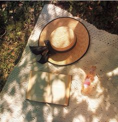 A good book and a hat on a sunny place with still shadow.