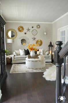 Neutral formal living room with fall decor and sunburst gallery wall in gold and silver