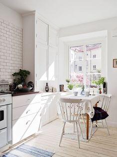 White kitchen. Via c o z y