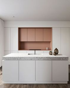 Eclectic kitchen with pink cabinets and terrazzo countertop #kitchencountertops