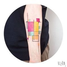 Abstract style composition on the left inner forearm. Tattoo...