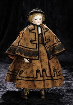 Soirée: A Marquis Cataloged Auction of Antique Dolls and Automata - May 14, 2016: Lot 8. Early French Porcelain Poupee with Rare Body, Porcelain Arms, and Original Costume
