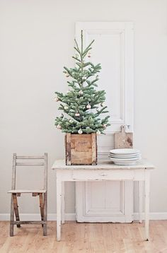 Simple Christmas Display with tree inside of crate from Dreamy Whites   Friday Favorites at www.andersonandgrant.com