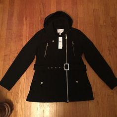 BCBGeneration Jacket BCBGeneration heavy weight black jacket. Adjustable belt, zipper and hood. Super cute and stylish. Water proof and NEVER WORN. NWT Size L NO TRADES PLEASE. :)) BCBGeneration Jackets & Coats