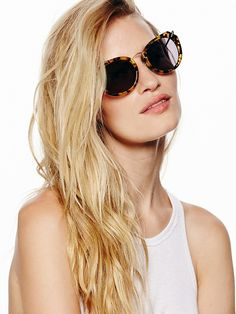 Tortoise sunnies with round lenses and metal arms, 155.00