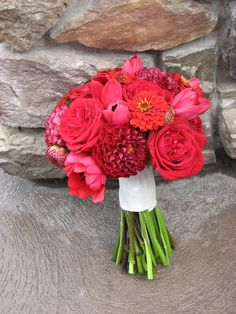 Red Bouquet of roses, zinnias, dahlias, and tulips.