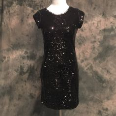 Black or gold fabulous sequin dress Amazing black or gold sequin dress.  Available in small, medium, and large. 100% Polyester. Message me to create your own listing Lewboutiquetwo Dresses Mini