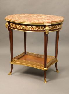 "A Bronze Mounted Marble Top Table With Ram's Masks 1887 France. 32""H x 31.5""W x 26""D."