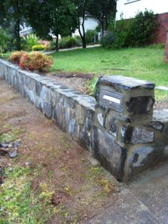 www.pavingcanberra.com Stone Retaining Wall. Retaining Wall Product: Blue stone - Wee Jasper stone Retaining Wall Design: Rock wall under 1 meter in height Drainage: Weep holes and 7mm River stones behind wall Retaining Wall Design, Stone Retaining Wall, Landscaping Retaining Walls, Synthetic Lawn, Pool Coping, River Stones, Rock Wall, Jasper Stone, Raised Garden Beds