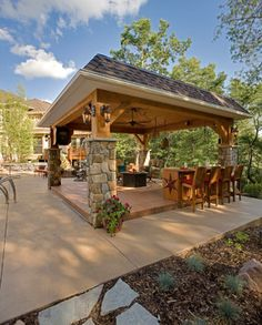 This pergola comes equipped with and outdoor bar.