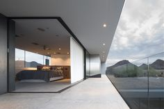 A corner Multi-Slide Door transitions the master bedroom onto the patio, allowing the Staabs to sleep en plein air.