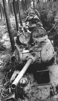 Column of T-34-85 medium tanks in a forest near Berlin, 1st Ukrainian Front, April 1945.