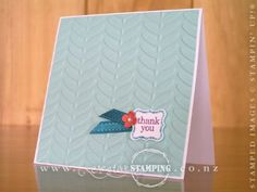 """This cute little note card showcases four products from the Sale-A-Bration catalogue:    Vine Street Textured Impressions Embossing Folder - a gorgeous leafy texture that is sure to create an impression!     Pretty Petites Stamp Set - is a very cute and versatile stamp set.     Petite Curly Label Punch - made to fit the Pretty Petites stamp set, but can be used for so much more.      Island Indigo 1/4"""" satin ribbon from the Sycamore Street Ribbon & Button Pack."""