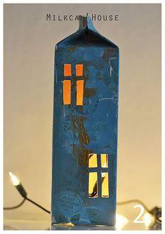 Painted milk carton, window cutouts, twinkle lights...