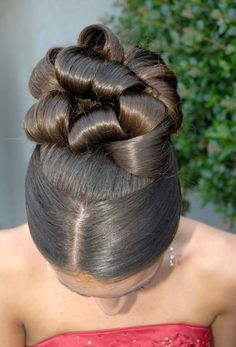Back in the day I did hair up dos just like this........they were called barrel curls.
