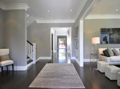 Dark Hardwood Floors, Grey Walls, White Molding/Baseboards- our new home's theme in a nutshell. House, Living Room Paint, Home, Home Remodeling, Grey Walls, New Homes, House Interior, Living Room Grey, White Molding
