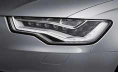 Much like a person's eyes, great-looking headlights can make or break a car's beauty. It's great when a manufacturer takes the time to design the inside of the headlight housing to provide a distinctively sharp arrangement of contours. I love the growing practice of putting large strips of light silver and/or LED strips to do this. Audi nails it every time: