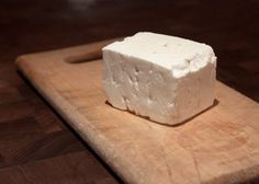 "Feta Country of Origin: Greece  Type of milk: Sheep and goat  Aging: About 3 months  Tasting Notes: Feta is one of the many cheese worldwide to be a protected designation of origin product, meaning that a cheese may only bear the label ""feta"" in the E.U. if it comes from either mainland Greece or Lesbos, and is made with at least 70% sheep's milk (the remainder must be goat's milk). A brined cheese, it is made by soaking freshly pressed curds in salt water. Tangy and moist."