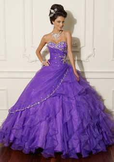Long strapless purple evening dress with tiered flounces from Vizcaya By Mori Lee (Style: 88009).