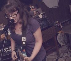 Lindsay Minton is a Jersey native, high school English teacher, and front woman of Texas trio Football, etc. She wants to write sad songs about something other than herself.
