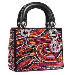 2c6ac210a #Carteras Estampas · Círculos y óvalos coloridos, un signo inequívoco de  los estampados africanos, de la casa