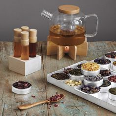 this holistic tea set invites you to sip from an array of nine herbs and three varieties of eco-certified, organic green tea from japan, india, and sri lanka. Cocinas Color Chocolate, Chai Tee, Tea For Colds, Tea Warmer, Deco Restaurant, Glass Teapot, Tea Brands, Tea Packaging, Tea Gifts