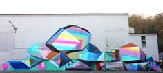 Austin-based artist josef kristoletti just finished 'protein lite' - his latest piece in panama city - rendering colorful three-dimensional looking prisms. the mural was painted for the first biennial of the south in panama 2013 - Thanks DesignBoom