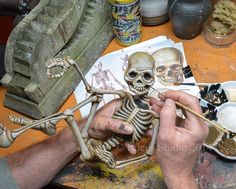 Scott Smith painting a skeleton © Rucus Studio 2014