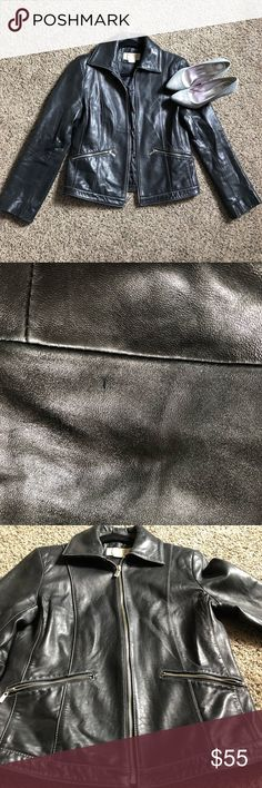 Michael Kors leather jacket Michael Kors black butter soft leather jacket, with silver hardware. In good used condition. Will look great with dresses, jeans, and leggings. Not too heavy, to use For errands or movie date. Please see pics for any worn areas, only has one minor cut as shown on 2nd pic, not noticeable when it's being worn. Zippers run very smooth. Michael Kors Jackets & Coats