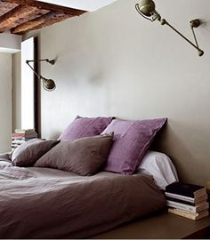 Subtle pops of color, neat wall lamps. Looks so cozy! I'm getting new bedding soon, and I'm feeling inspired...