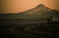 alone on the road ...almost - one of the few trucks on the road coming back home from Oregon at sunset with Mt Ranier in the background.