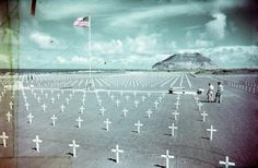 A view of the cemetery containing the dead of the 3rd, 4th, and 5th United States Marine Divisions on the island of Iwo Jima. Mount Suribachi is seen in the distance, looking from North to South. Following the war, families could have their loved one's remains returned to the states for re-burial. All of the Marines buried here in this cemetery were removed and brought home before the island was turned back over to the Japanese government. However, many American remains are still on the…