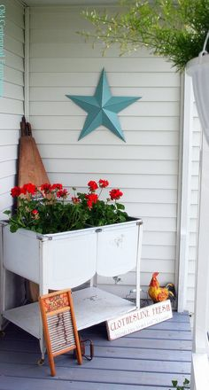 Vintage washtubs hold bright red geraniums in a display dedicated to laundry! <--(from Old Centennial Farmhouse)
