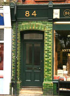 Victorian green subway tile surrounds a doorway in Lewes UK. Glazed Brick, Glazed Tiles, Portal, Shop Doors, House Front, Closed Doors, Doorway, Door Knobs, Architecture Details