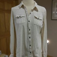 Ruff Hewn Patterned Cream Top Size medium cteam colored top. Has pattern/texture. Brass buttons. Sleeves can be worn up with a button (see pic 3). Ruff Hewn Tops Button Down Shirts