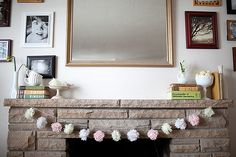 Easy, pretty, and cheap - tissue paper flower pom-pom garland. What more could we want? Here's the tutorial.