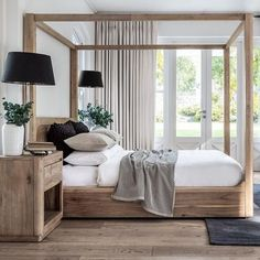 Meet the Bogard four poster bed - a tribute to clean, contemporary design, the classic four poster bed frame delivers style from all… Bedding Master Bedroom, Home Bedroom, Bedroom Furniture, Queen Bedroom Sets, Modern Master Bedroom, Smart Furniture, Furniture Market, Furniture Movers, Queen Beds