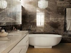 Looks like a sumptuous marble wall, doesn't it? Surprise, surprise: It's porcelain. Porcelain has come such a long way in recent years. It can duplicate the look of stone or metal, but without any of the care concerns of either of those materials.