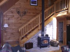wood stove against staircase