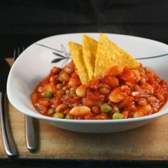 Veggie Chili recipe 1 lb ground beef 1 large onion, diced 1 red bell pepper, diced 1 yellow or green bell pepper, diced 2 stalks celery, diced 3 cloves garlic, diced 2 cups kernel corn 2 - 16 oz cans chili beans 1 - 16 oz back beans 1 - 28 oz can tomato sauce 1 - 6 oz can tomato paste 1 tablespoon cumin 1 tablespoon coriander 1 teaspoon dried oregano 1 teaspoon dried cilantro 1/2 tsp chili powder 1 cup beef broth salt and pepper olive oil
