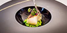 Black cod with petit pois and pea shoots