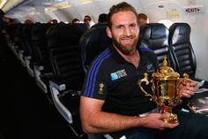 2015 NOVEMBER 05. Kieran Read of the All Blacks poses with the Webb Ellis Cup enroute to Christchurch for the New Zealand All Blacks welcome home celebrations.