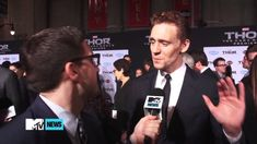 """Tom Hiddleston Breaks Into Tears At Thor 2 Premiere - I JUST WATCHED THIS VIDEO AT LEAST TWELVE TIMES AND I'M SERIOUSLY CRYING WITH HIM BECAUSE I CAN SEE THE MOMENT WHEN IT HITS HIM AND HE TRIES TO LAUGH OFF HIS SUDDEN PAIN AND HE LITERALLY GOES FROM AN ATTEMPT AT LAUGHTER TO QUIVERING LIP AND I CAN'T HANDLE IT. This can't be his last Marvel movie! It just can't!"" No No NO bby don't cry! it's ok baby! Josh Harowitz how dare you make this angel cry!!!"
