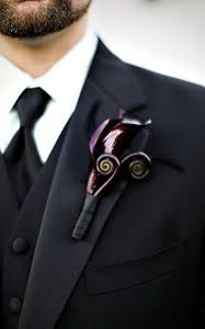 This boutonniere, designed with black mini calla and fiddle fern, is the perfect mix of stylish and masculine.