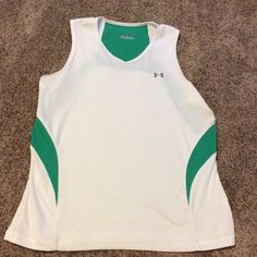 Under Armour running tank top Great condition. Worn a few times only. Not holes, stains or snags.  Size medium. Tag does not specify fit but I would call it a loose fit. Reflective strip on back. Under Armour Tops Tank Tops