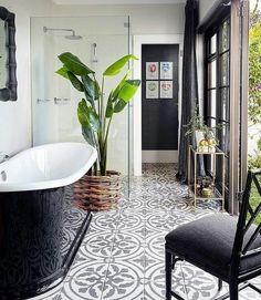 Love these tiles! Black and white bathroom features a glossy black freestanding tub atop a black and white concrete tile floor which continues into the seamless glass glass shower which is placed next to the tub. Bathroom Floor Tiles, Bathroom Renos, Bathroom Interior, Small Bathroom, Tiled Bathrooms, Kitchen Floor, Bathroom Black, Master Bathroom, Remodel Bathroom
