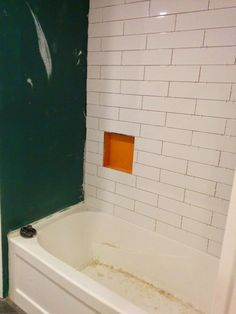 Choosing our shower tile design with subway tile and marble tile niche. This white and gray bathroom features IKEA vanities and herringbone floor. Bathroom Renos, Grey Bathrooms, Bathroom Tiling, Ikea Vanity, Shower Tile Designs, Marble Tiles, Home Improvement, Bath Ideas, Subway Tiles